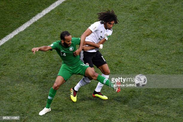 Abdullah Otayf of Saudi Arabia battles for possession with Mohamed Elneny of Egypt during the 2018 FIFA World Cup Russia group A match between Saudia...