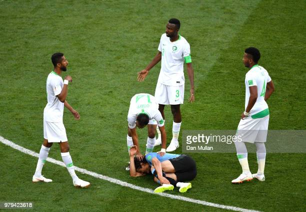 Abdullah Otayf of Saudi Arabia checks on Edinson Cavani of Uruguay who goes down injured during the 2018 FIFA World Cup Russia group A match between...