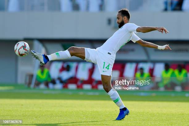 Abdullah Otayf of Saudi Arabia in action during the AFC Asian Cup round of 16 match between Japan and Saudi Arabia at Sharjah Stadium on January 21...