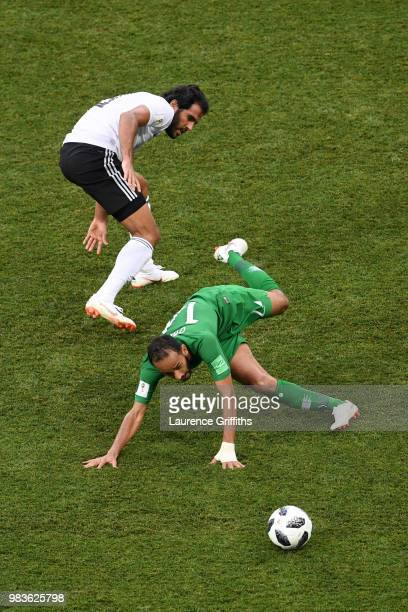 Abdullah Otayf of Saudi Arabia is challenged by Marwan Mohsen of Egypt during the 2018 FIFA World Cup Russia group A match between Saudia Arabia and...