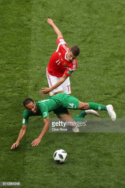 Abdullah Otayf of Saudi Arabia is fouled by Roman Zobnin of Russia during the 2018 FIFA World Cup Russia Group A match between Russia and Saudi...