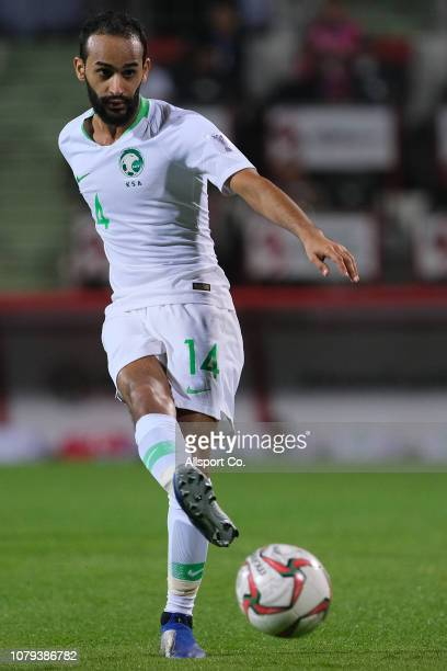Abdullah Otayf of Saudi Arabia kicks the ball during the AFC Asian Cup Group E match between Saudi Arabia and North Korea at Rashid Stadium on...
