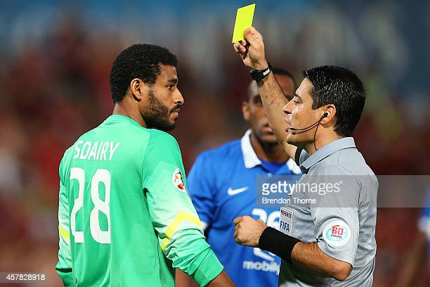 Abdullah Sdairy of AlHilal receives a yellow card from referee Alireza Faghani during the Asian Champions League final match between the Western...