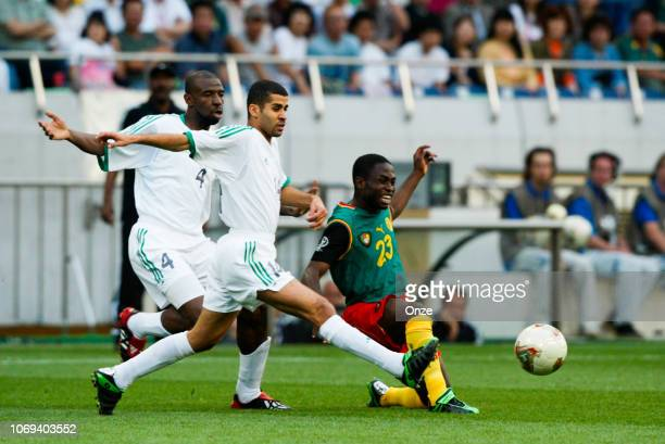 Abdullah Sulaiman ZUBROMAWI and Abdulaziz KHATHRAN and Daniel NGOM KOME during the FIFA World Cup match between Cameroon and Saudi Arabia on June 6...