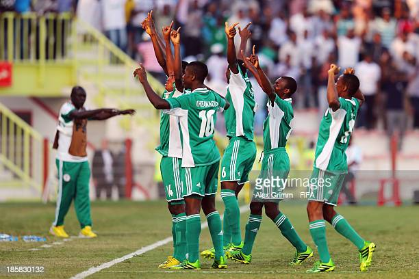 Abdullahi Alfa of Nigeria celebrates his team's second goal with team mates during the FIFA U17 World Cup UAE 2013 Group F match between Nigeria and...
