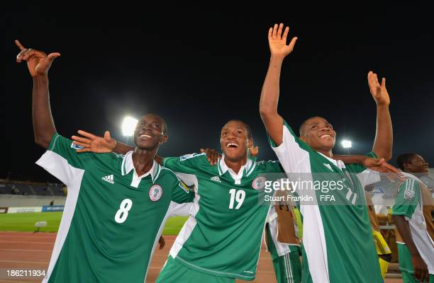 Abdullahi Alfa, Zaharaddeen Bello and Musa Yahaya of Nigeria celebrate their teams win at the end of the round of 16 match between Nigeria and Iran...