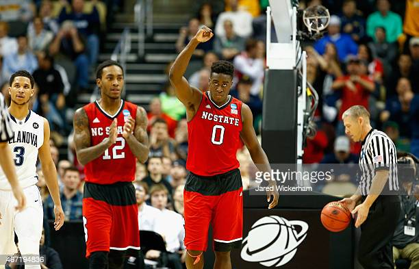 AbdulMalik Abu of the North Carolina State Wolfpack celebrates next to teammate Anthony Barber during the closing minutes of their 7168 win over the...