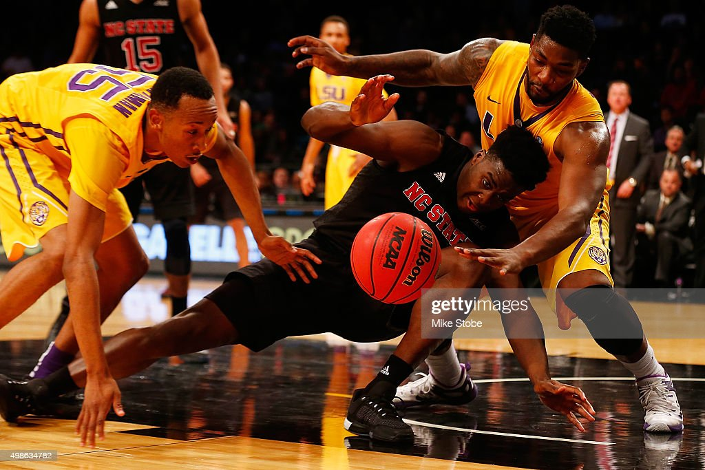 Abdul-Malik Abu #0 of the North Carolina State Wolfpack fights for the ball against Brian Bridgewater #20 and Tim Quarterman #55 of the LSU Tigers at Barclays Center on November 24, 2015 in Brooklyn borough of New York City.