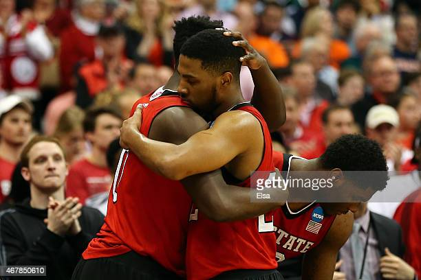 AbdulMalik Abu of the North Carolina State Wolfpack hugs Ralston Turner of the North Carolina State Wolfpack in the second half of the game against...