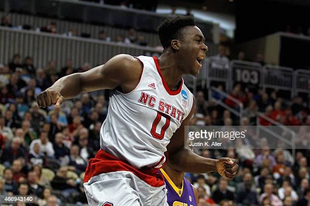 AbdulMalik Abu of the North Carolina State Wolfpack reacts after dunk in the second half against the LSU Tigers during the second round of the 2015...