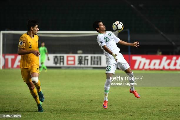 Abdulmohsen Alqahtani of Saudi Arabia blocks the ball during the AFC U19 Championship Indonesia quarter final match between Saudi Arabia and...