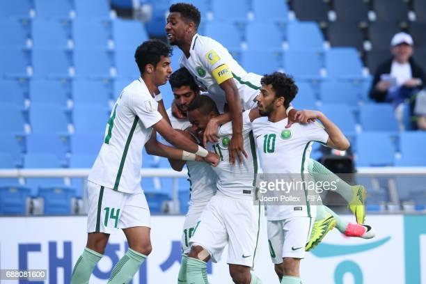 Abdulrahman Alyami of Saudi Arabia celebrates with his team mates after scoring his team's first goal during the FIFA U-20 World Cup Korea Republic...