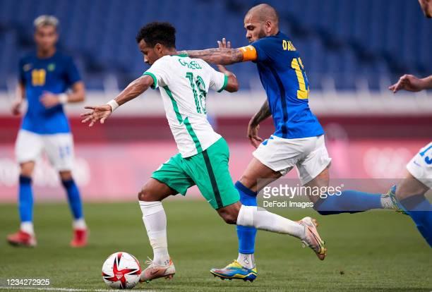 Abdulrahman Ghareeb of Saudi Arabia and Dani Alvez of Brazil battle for the ball during the Men's Group D match between Saudi Arabia and Brazil on...