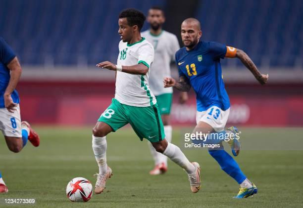 Abdulrahman Ghareeb of Saudi Arabia controls the ball during the Men's Group D match between Saudi Arabia and Brazil on day five of the Tokyo 2020...