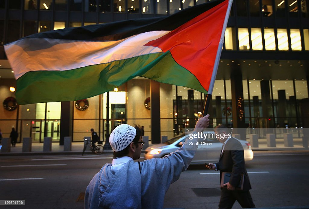 Abdur Rahman waves a Palestinian flag as he participates in a demonstration calling for an end to Israeli attacks on Gaza on November 19, 2012 in Chicago, Illinois. Several hundred protestors rallied in the Federal Building Plaza before marching through the Loop during rush hour.