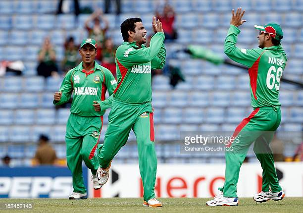 Abdur Razzak of Bangladesh celebrates the wicket of New Zealand's Martin Guptill with Nasir Hossain during the ICC World T20 Group D match between...