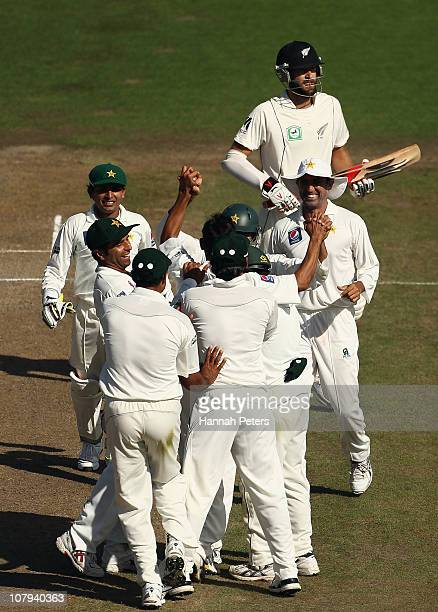 Abdur Rehman of Pakistan celebrates the wicket of Daniel Vettori of New Zealand of New Zealand during day three of the First Test match between the...