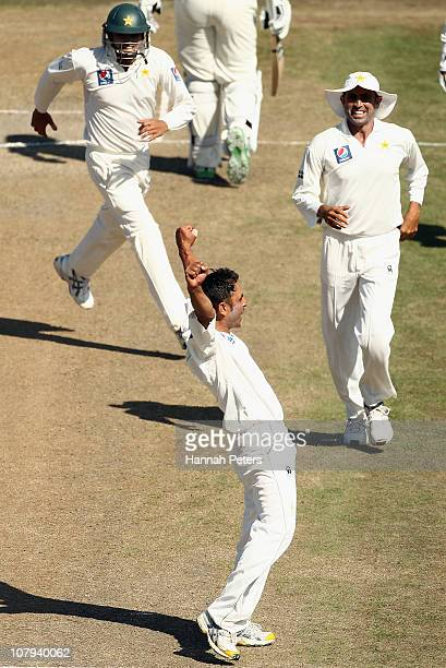 Abdur Rehman of Pakistan celebrates the wicket of Martin Guptill of New Zealand of New Zealand during day three of the First Test match between the...