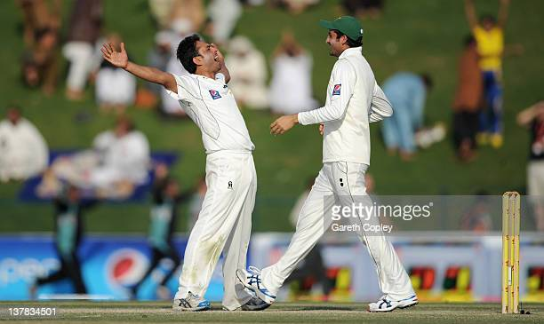 Abdur Rehman of Pakistan celebrates with Junaid Khan after dismissing James Anderson of England to win the second Test match between Pakistan and...