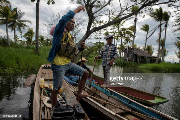Abdurajak Epon on a boat patrol at the end of their village with other residents against IS attacks on September 1 2018 in Datu Piang Maguindanao...