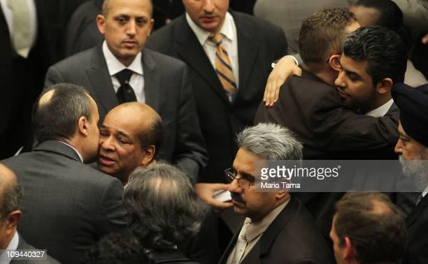 Abdurraham Mohamed Shalgam , Libya's United Nations ambassador, is hugged by a diplomat after denouncing Libyan leader Muammar Gaddafi for the first...