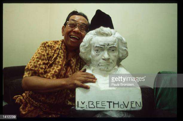 Abdurrahim Wahid chairman of the National Awakening Party which is Indonesia''s largest Islamic group poses with a bust of Beethoven June 7 1999 in...