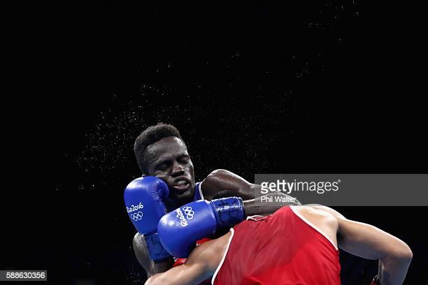 Abdyul Omar of Ghana flights Alberto Ezequiel Malian of Aregentina in their Mens Banbtamweight bout on Day 6 of the 2016 Rio Olympics at Riocentro...