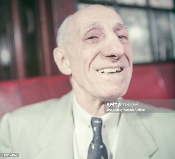 Abe Attell the greatest featherweight boxer that ever lived poses for a portrait while eating with friends at Jack Dempsey's resturant in New York...