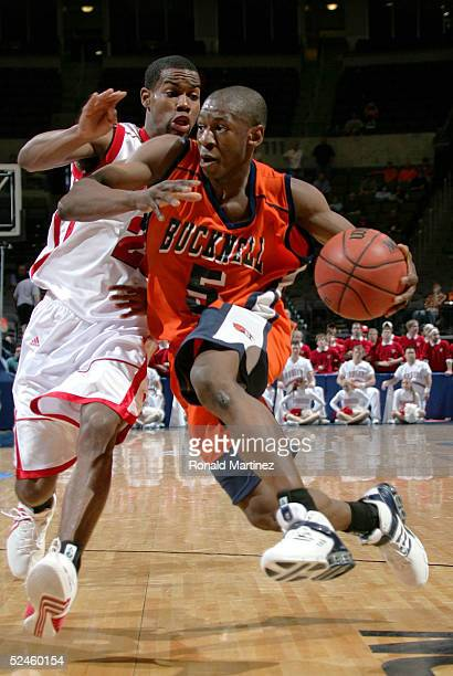 Abe Badmus of the Bucknell Bison drives to the hoop against Kammron Taylor of the Wisconsin Badgers during the second round of the NCAA Men's...
