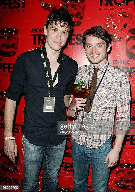 Abe Forsythe winner of 1st prize for 'Shock' poses with actor Elijah Wood during the Tropfest 2010 short film festival at The Domain on February 21...