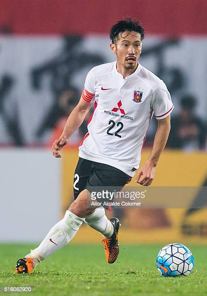 Abe Yuki of Urawa Red Diamonds in action during the AFC Champions League match between Guangzhou Evergrande and Urawa Red Diamonds on March 16 2016...