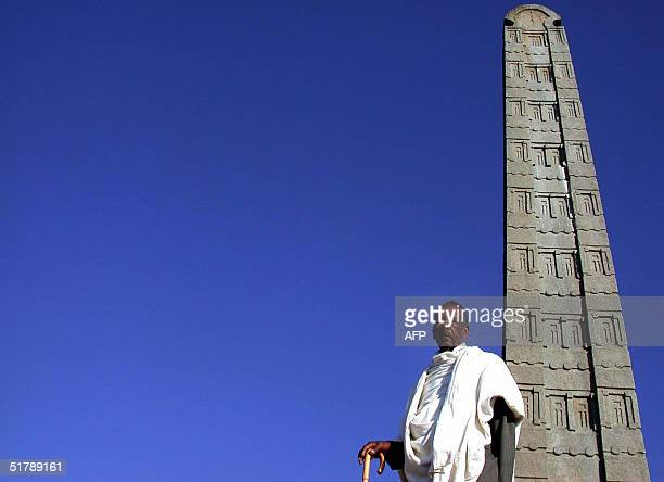 Abebe Alemayehu stands by the surviving Obelisk of Axum the twin of the one taken by Mussolini's troops in 1937 in Axum 19 November 2004 Alemayehu at...