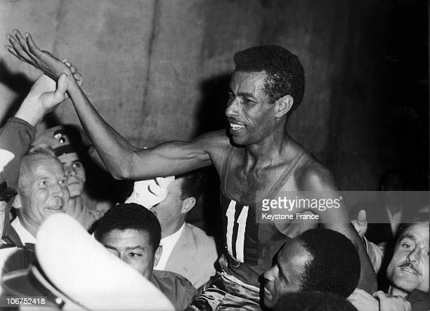 Abebe Bikila, An Ethiopian Marathon Runner, Victorious September 10, 1962 In The Olympic Games Marathon In Rome. He Is Carried In Triumph Upon His...