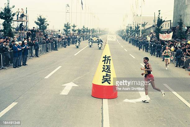Abebe Bikila of Ethiopia competes at the turn-around point in the Men's Marathon during the Tokyo Olympic on October 21, 1964 in Chofu, Tokyo, Japan.