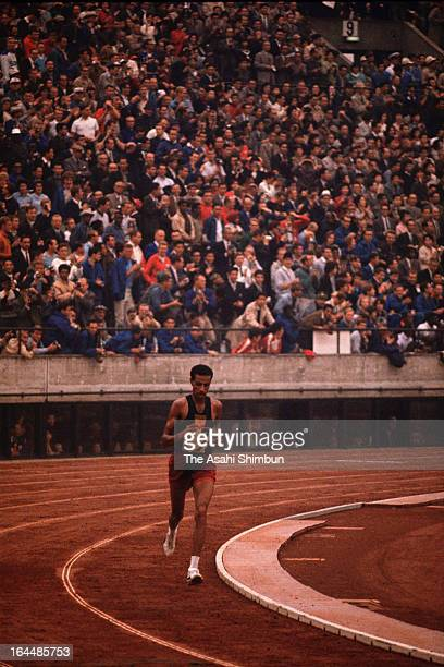 Abebe Bikila of Ethiopia competes in the Men's Marathon during Tokyo Olympic at the National Stadium on October 21, 1964 in Tokyo, Japan.