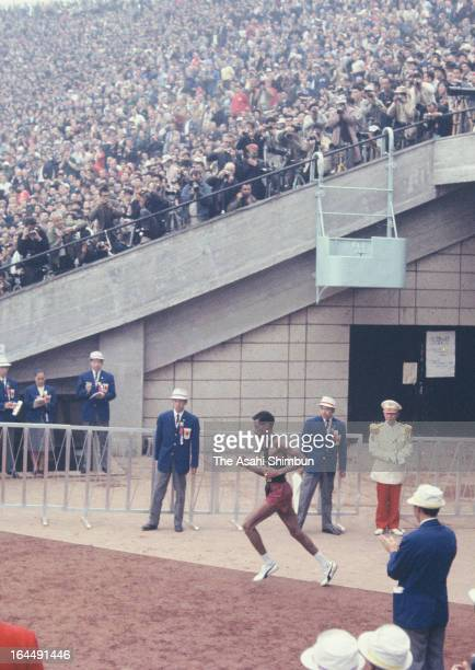 Abebe Bikila of Ethiopia competes in the Men's Marathon during Tokyo Olympic at the National Stadium on October 21 1964 in Tokyo Japan