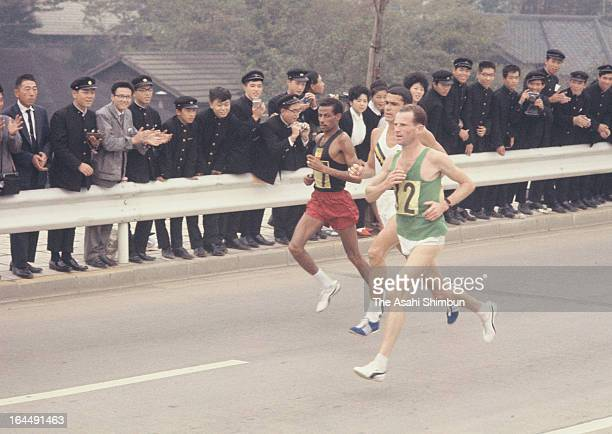 Abebe Bikila of Ethiopia competes in the Men's Marathon during Tokyo Olympic on October 21 1964 in Tokyo Japan