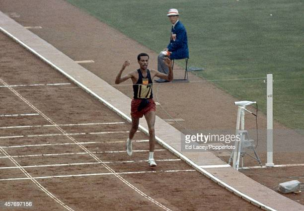 Abebe Bikila of Ethiopia winning the men's marathon in a world record time during the Summer Olympic Games in Tokyo circa October 1964