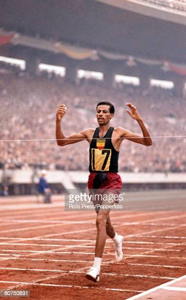 Abebe Bikila of Ethiopia crosses the finish line in first place to win the gold medal in the Men's marathon event in a world record time during the...