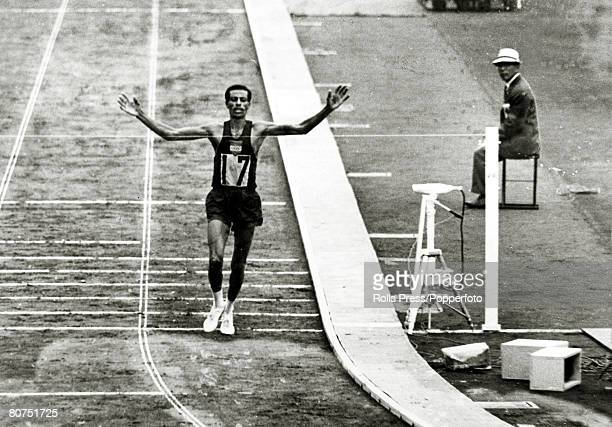 21st October 1964 1964 Olympic Games in Tokyo Ethiopia's Abebe Bikila breaks the tape to win the Men's Marathon winning the gold medal for the second...