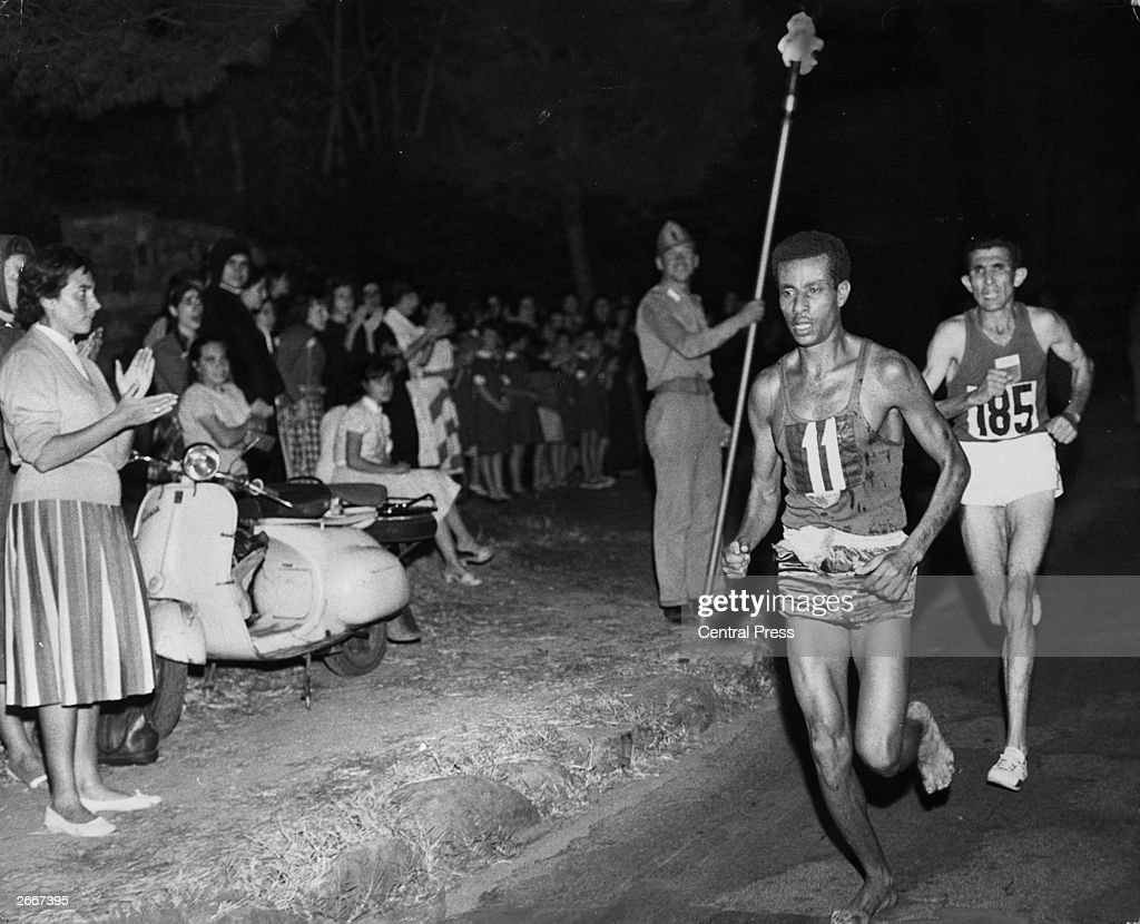 Abebe Bikila of Ethiopia, running barefoot, draws away from Abdesselem Rhadi of Morocco near the finish of the marathon at the 1960 Rome Olympics. He went on to win with a new Olympic record time of 2 hours 15 minutes 16 seconds.