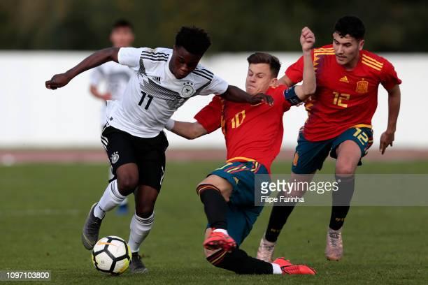 Abed Nankishi of Germany U17 challenges German Varela and David Bonilla of Spain U17 during U17Juniors Algarve Cup match between U17 Spain and U17...