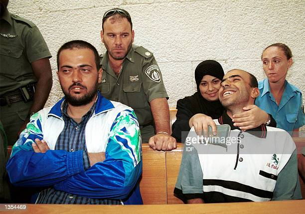 Abed Nassar Asida and Kifah Ajouri two of the three relatives of terrorists slated for deportation to Gaza listen to proceedings at Jerusalem's high...