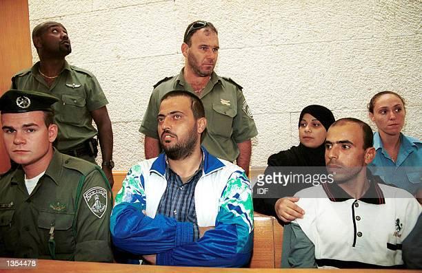 Abed Nassar Asida Kifah Ajouri and Intisar Ajouri the three relatives of terrorists slated for deportation to Gaza listen to proceedings at...