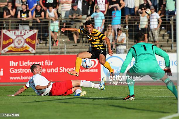 Abedin Krasniqi of Aachen in action with Daniel Flottmann and Andre Poggenborg of Cologne during the Regionalliga West match between Fortuna Koeln...
