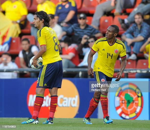 Abel Aguilar and Luis Perea from Colombia in action during a match between Colombia and Bolivia for the third round of Group A of Copa America 2011...