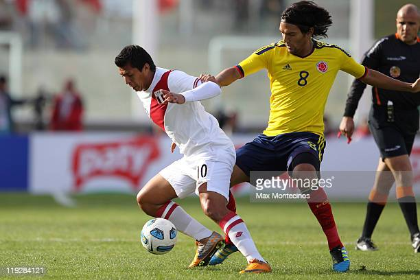Abel Aguilar from Colombia fights for the ball with Rinaldo Cruzado from Peru During a quarter final match between Colombia and Peru at Mario Alberto...