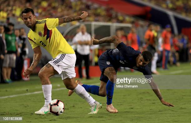 Abel Aguilar of Colombia and DeAndre Yedlin of Unites States fight for the ball during an International Friendly at Raymond James Stadium on October...