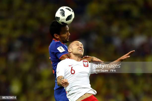 Abel Aguilar of Colombia and Jacek Goralski of Poland compete in the air for the ball during the 2018 FIFA World Cup Russia group H match between...