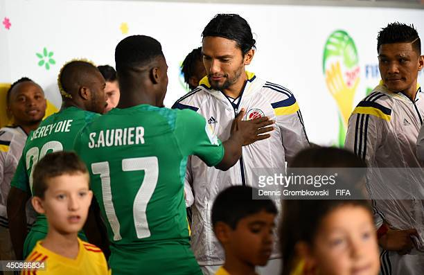 Abel Aguilar of Colombia and Serge Aurier of the Ivory Coast speak in the tunnel prior to the 2014 FIFA World Cup Brazil Group C match between...